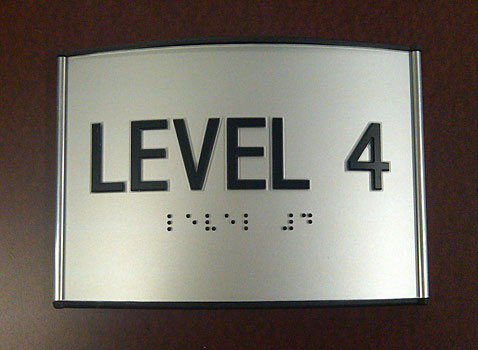 engraved business room sign